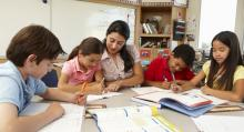 Group of students working with teacher