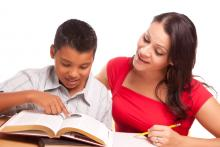 Student reading with teacher.