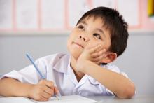 elementary male student studying
