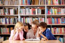 Elementary students reading in library
