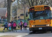 students boarding bus