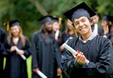 boy in graduation cap and gown