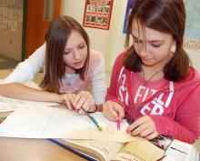 Students reading text.