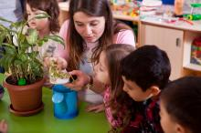 Students and teacher with plant