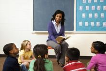 Teaching reading to her students